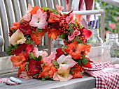 Late summer wreath made of gladioli, rowan berries and sedum