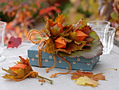 Gift decorated with physalis (lantern flower), Acer leaves