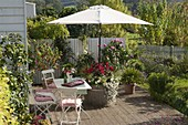 Planter with integrated parasol holder