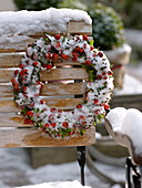 Wreath made of roses (rosehip), buxus (box) and buds of hedera