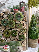 Rustic Christmas terrace with firewood pile