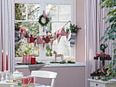 Advent calendar on window, gloves, bags and bags with numbers