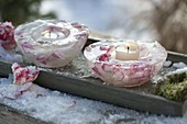 Homemade ice wind lights with rose petals