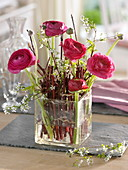 Dogwood branches as plug-in aid for ranunculus bouquet