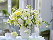 White-yellow bouquet with Dianthus (carnation), ranunculus