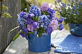 Blue-pink bouquet in blue pitcher