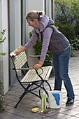 Spring cleaning, woman cleans garden bench
