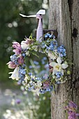 Small wreath from Myosotis, Aquilegia, Galium