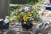 Colorful early summer bouquet with Arnica montana, Rose