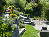 Hillside garden with granite wall terraced