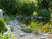 Path made of gravel and natural stones near the pond