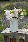 Pink 'New Dawn' (climbing rose) bouquet in enamel jug
