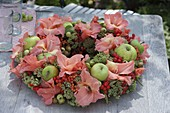 Late-summer wreath of gladiolus, apples and ornamental apples