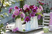 Rose and pink dahlia in enamelled pots