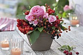 Small bouquet of pink (rose and rosehips), elderberries