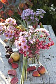 Small bouquets of aster and fruit stalls of Euonymus