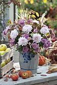 Peasant autumn bouquet in a lard box