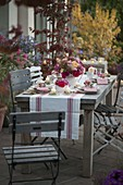 Autumnal rose table decoration on the terrace
