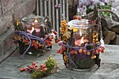 Preserving jars as lanterns, autumn decorated with bark, malus