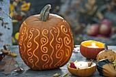Ornamental carved pumpkin (Cucurbita) with ornaments