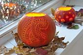 Decorative carved pumpkins (Cucurbita) as lanterns