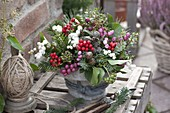 Autumnal berry bouquet with coniferous branches