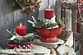 Red candles with betula bark and twigs, pinus cones