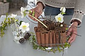 Christian Rose cinnamon sticks flower arrangement