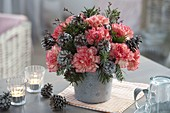 Winter bouquet made of Dianthus (carnation), Abies twigs
