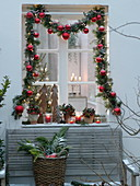 Christmas window decoration with a view into the room
