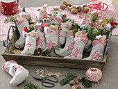 Advent calendar made of stuffed fabric ankle socks on a wooden tray