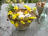 Floating candles in conical bowl with wreath of Salix branches