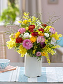 Colorful ranunculus and acacia spring bouquet