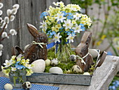 Easter basket with a small Primula veris bouquet