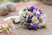 Small spring bouquet with viola odorata and bellis perennis