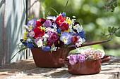 Colorful spring flowers in enamel pots