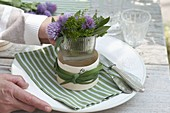 Herb bouquet in cheese box as napkin decoration