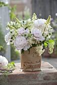 White bouquet from Lupinus, Paeonia, Sambucus