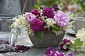 Fragrant arrangement of pink (rose), Paeonia (peony)