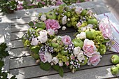 Summer wreath of pink, green apples, currants