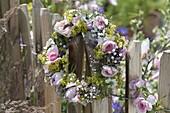 Flower wreath on the fence, Rose, alchemilla, nigella