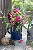 Blue pitcher with Antirrhinum (snapdragon) and sage