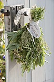 Herbal bouquet on the door handle