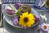 Table decoration with sunflowers, decorative baskets and apples