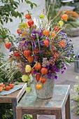 Autumn bouquet with physalis, aster, sedum