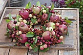 Fruit wreath with apples, ornamental apples and Rose