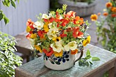 Bouquet of edible flowers and herbs
