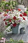 Late summer bouquet in enameled Bucket Cosmos