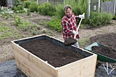 Build a raised flower bed of boards