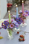 Candlelight with aster and Rose in row